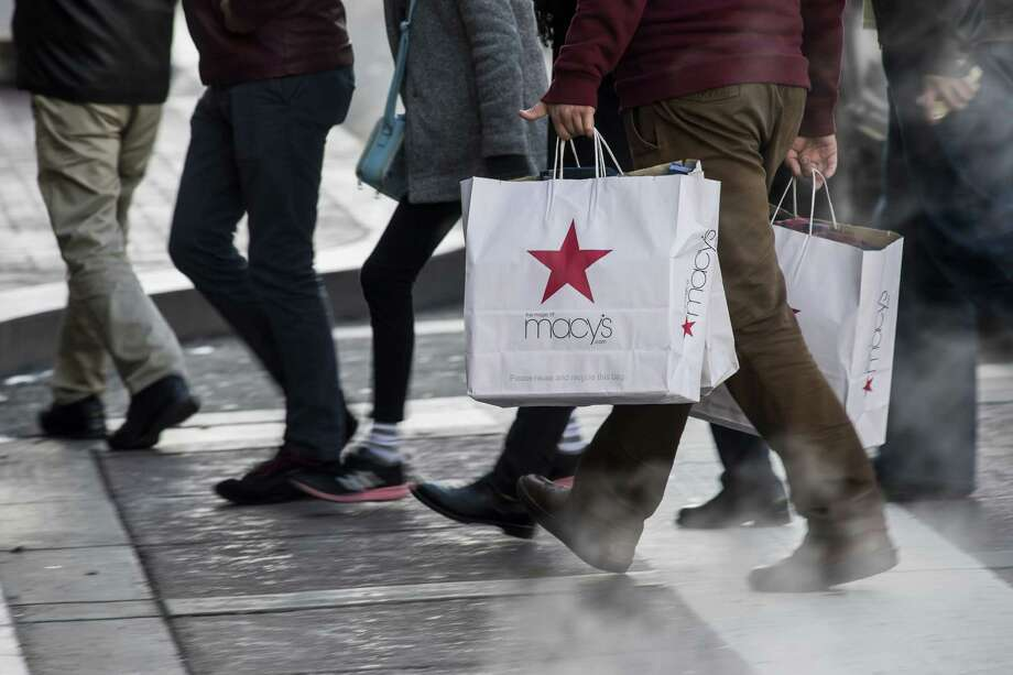 A shopper carries Macy's Inc. shopping bags in San Francisco, California, U.S., on Monday, Dec. 26, 2016. Photographer: David Paul Morris/Bloomberg Photo: David Paul Morris / © 2016 Bloomberg Finance LP
